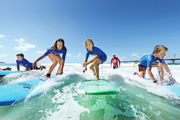 Surf lessons with Wave Riding Vehicles Surf Camp